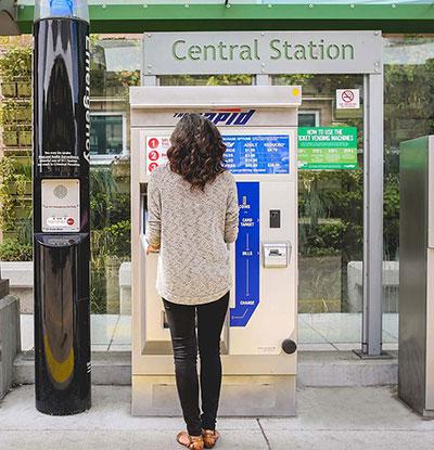 Person facing rapid fare kiosk