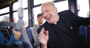 Fr. Mark at bus stop